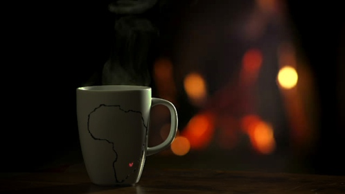 coffee mug next to fire