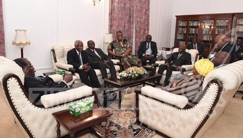 President Mugabe meets ZDF Commander and SA envoys at State House