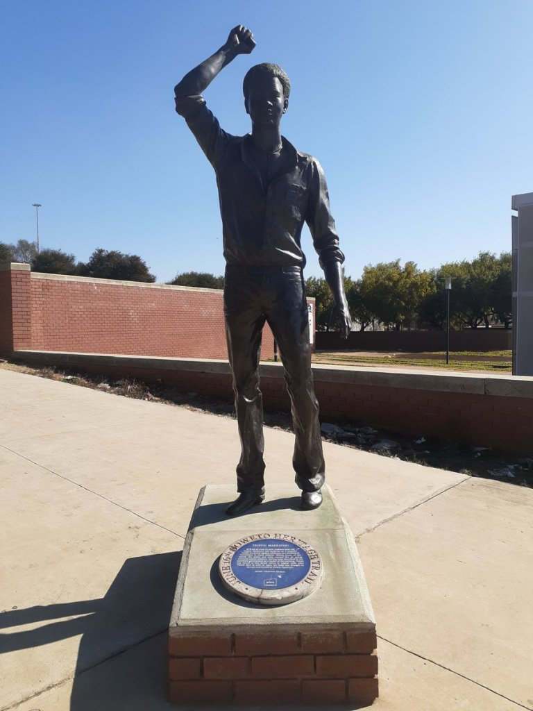 a statue of Tsietsi Mashinini. Hoisting his right fist upwards, in the universal gesture signalling the mobilisation of people to reclaim power and influence, and embrace their liberation