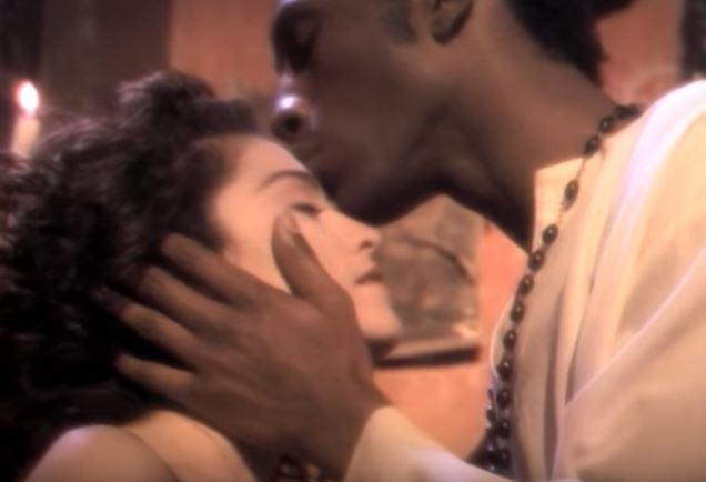 Madonna Kissed by Black Saint