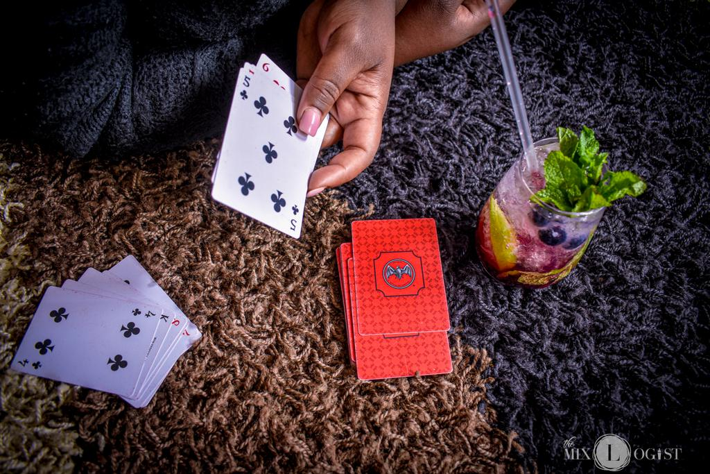 A game of crazy 8 and a blueberry Mojito