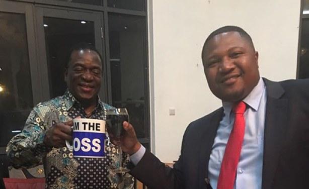 Mnangagwa holds boss mug