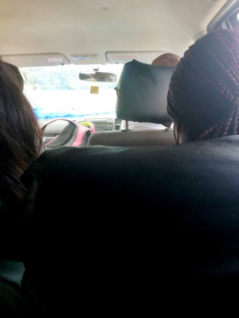 ride sharing passengers in a Toyota Wish pirate taxi