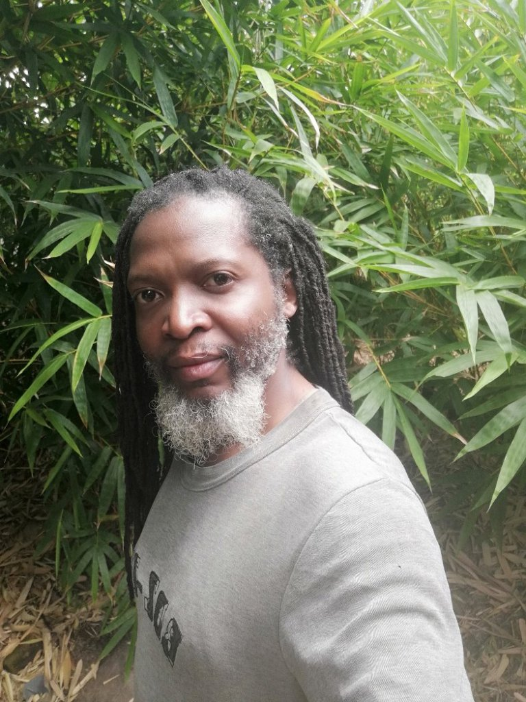 Uncle Beaton with salt and pepper dreadlocks