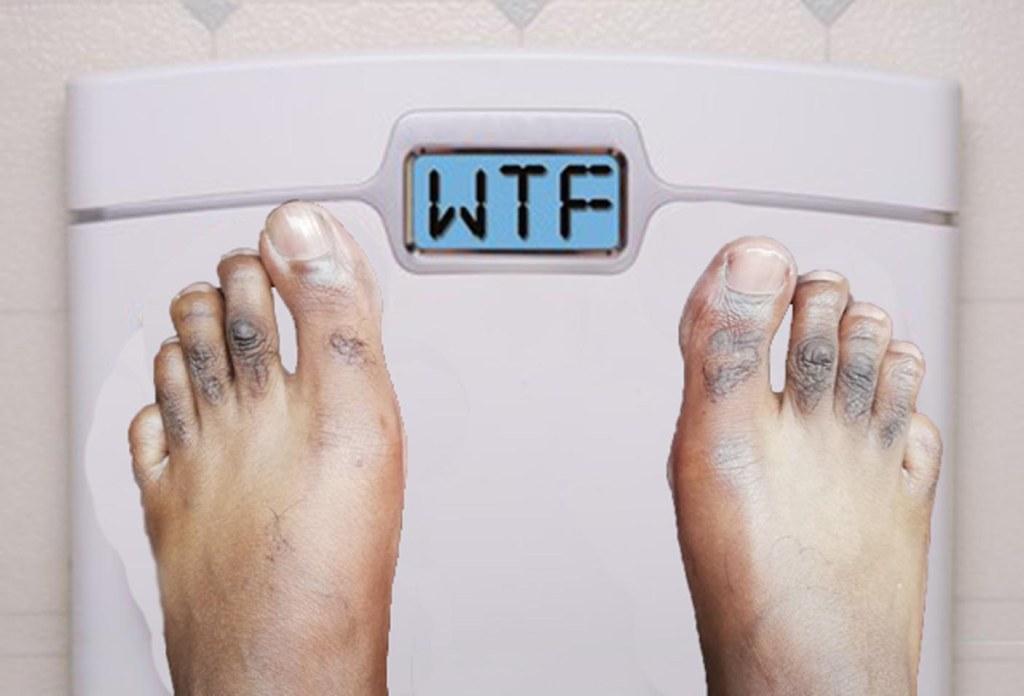 feeet on bathroom scale with WTF
