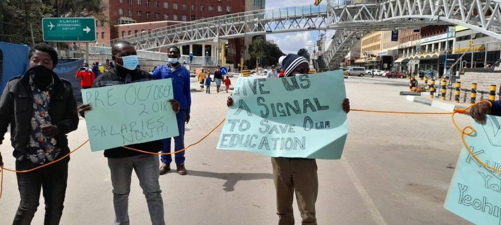 Give us a signal  Artuz teachers at Mbuya nehanda statue