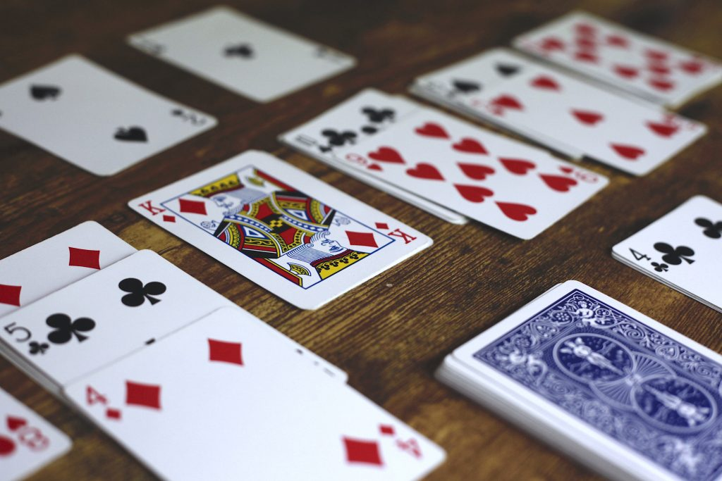 playing solitaire with a deck of cards